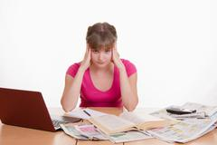 the girl has a headache from job search - stock photo