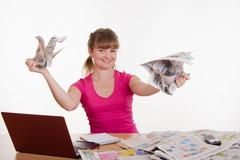 Stock Photo of the girl behind the desk tearing paper