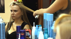 Woman with long hair at the beauty salon getting a blower Stock Footage