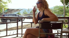 Beautiful Young Casual Woman Smoking Outdoors. Stock Footage
