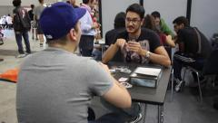 Two player playing to a card role game Stock Footage