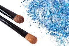 Crumbled eyeshadow with brush Stock Photos