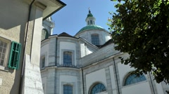 Europe Switzerland city of Solothurn 030 catholic cathedral and a house corner Stock Footage