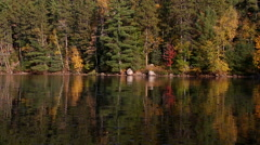 Fall colors reflected in the water Stock Footage