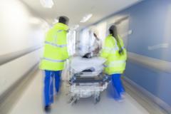 Motion blur stretcher gurney patient hospital emergency Kuvituskuvat