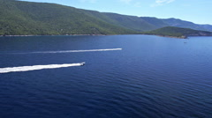 Aerial - Two speedboats sailing on water by the coast Stock Footage