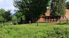 Pan Shot of Log Cabin on a Farm Stock Footage