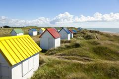 colorful beach cabins at gouville-sur-mer, normandy - stock photo