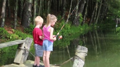 Young Girl Reels in her Fishing Line Stock Footage