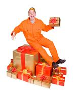 cheerful man in a work suit with gifts - stock photo