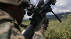 Soldier firing a rifle Stock Footage
