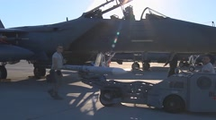 A missile is unloaded from an F-15E Eagle Stock Footage