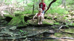 Young Boy and Girl Play in Brook with Sticks (HD) Stock Footage