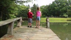 POV of Young Children Fishing off a Dock  (HD) Stock Footage