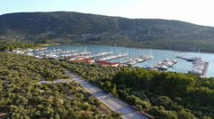 Aerial - Marina with sailboats from the distance Stock Footage