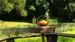 Basket with grape and peach fruit and glass with champagne cider Stock Footage