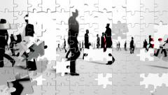 Puzzle pieces fly in and form silhouetted people walking from left and right. Stock Footage