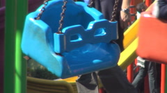 Colorful carousel spinning with childrens in a playground. Stock Footage