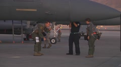Aircrew members perform a preflight inspection on an F-15E before takeoff  Stock Footage