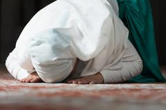 Humble muslim prayer woman Kuvituskuvat
