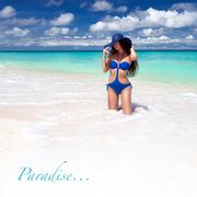 beautiful tan woman posing on tropical beach - stock illustration