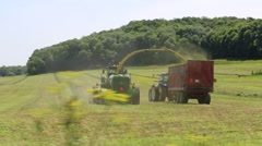 Harvest Combine Loading Alfalfa in Cart Stock Footage