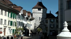 Europe Switzerland city of Solothurn 044 street train drives through town gate Stock Footage