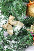 Decoration golden billow on new year tree branch Stock Photos