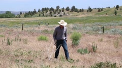 Young Cowboy/Rancher Walks Toward the Camera - stock footage