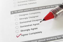 Closeup of a survey form, with agree completely checked Stock Photos