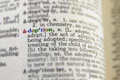 Closeup of adoption definition in colorful letters Stock Photos