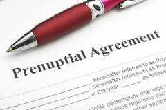 closeup of a marriage prenuptial agreement - stock photo