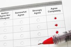 Closeup of a survey form with agree remarks checked Stock Photos
