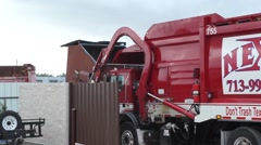 Garbage Truck Collects Waste From Dumpster - stock footage