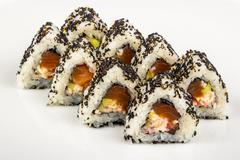 triangular sushi with sesame seeds - stock photo