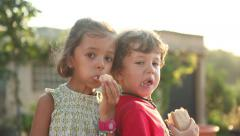 Boy and girl eating snack, brother and sister Stock Footage
