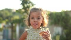 Girl eating snack Stock Footage