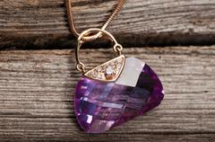 Elegant jewelry on wooden background - stock photo