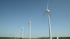Windmill farm on a sunny day  Stock Footage