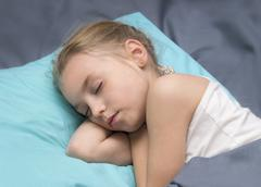 Sick girl is sleeping Stock Photos
