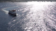 Tender Boat Returning to Cruise Ship Stock Footage