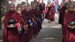 Novice Buddhist Monks Lining Up at Mahagandayon Monastery in Mandalay, Myanmar Stock Footage
