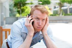 closeup portrait, young man annoyed, frustrated, pissed off by someone listen - stock photo