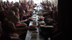 Buddhist Monks Eating Lunch at Mahagandayon Monastery in Mandalay, Myanmar Stock Footage