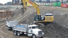 Crawler Excavator Loading Truck - stock footage