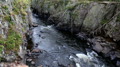 Rocky river gorge over cliff static shot Stock Footage