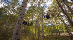 Timelapse of Camping Utensils hanging from Aspen trees Stock Footage