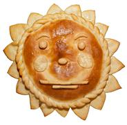 humor.bread as a sun with a smile .smiley with a serious person - stock photo