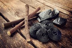 Production steps of licorice, roots, pure blocks and candy. Stock Photos