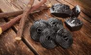 Stock Photo of production steps of licorice, roots, pure blocks and candy.